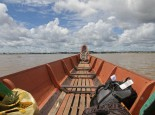 A pirogue crosses from Suriname into French Guiana.